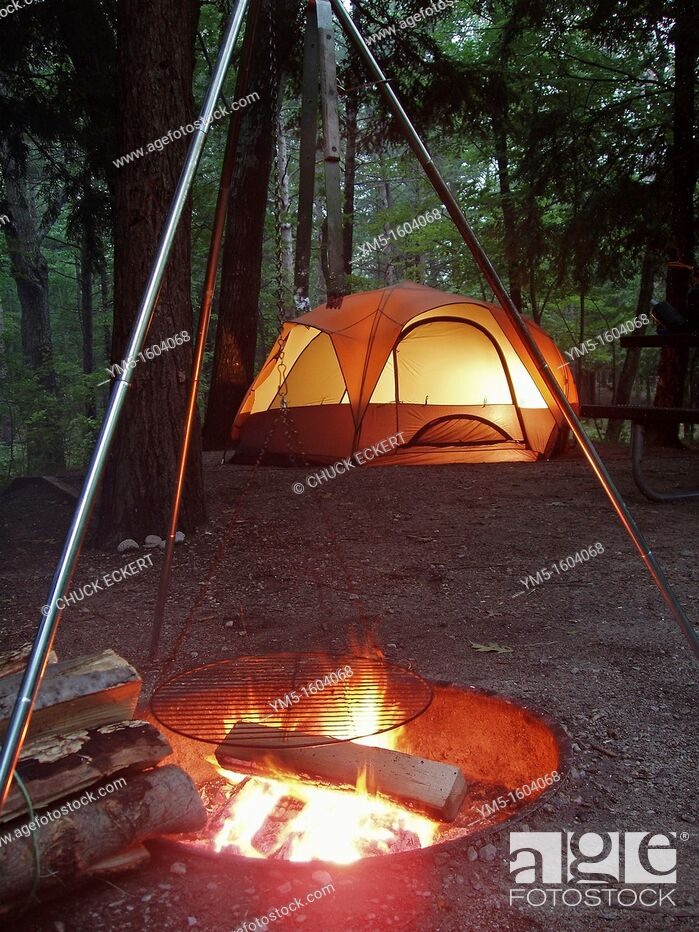 Stock Photo: Campsite at dusk with campfire & tent.