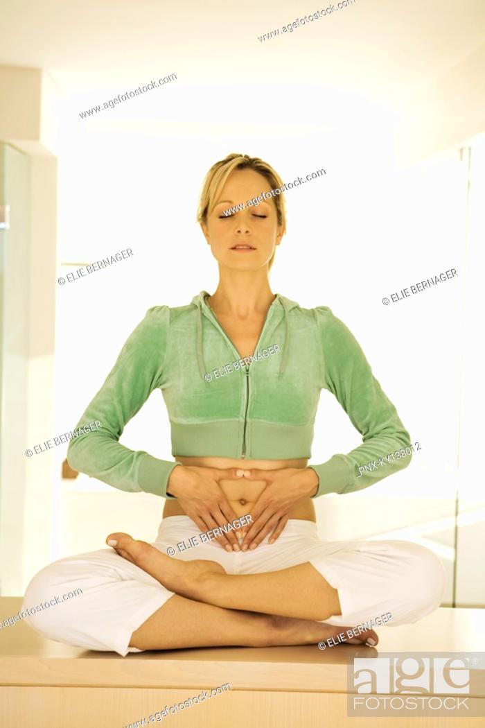 Stock Photo: Young woman in yoga position.