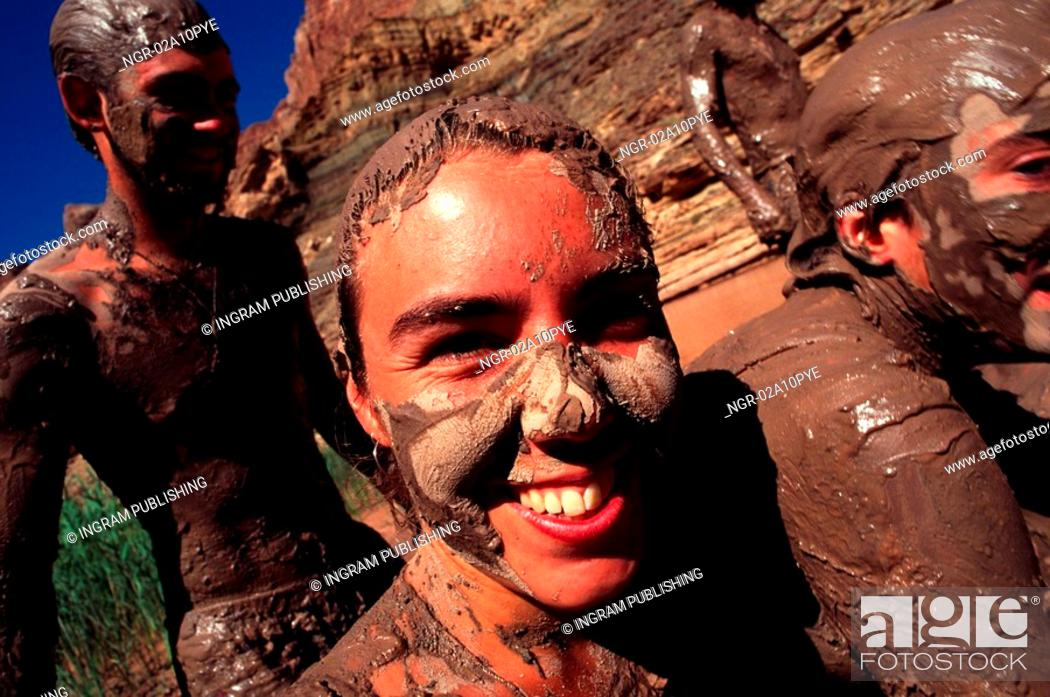 Stock Photo: group of friends at a mud bath.