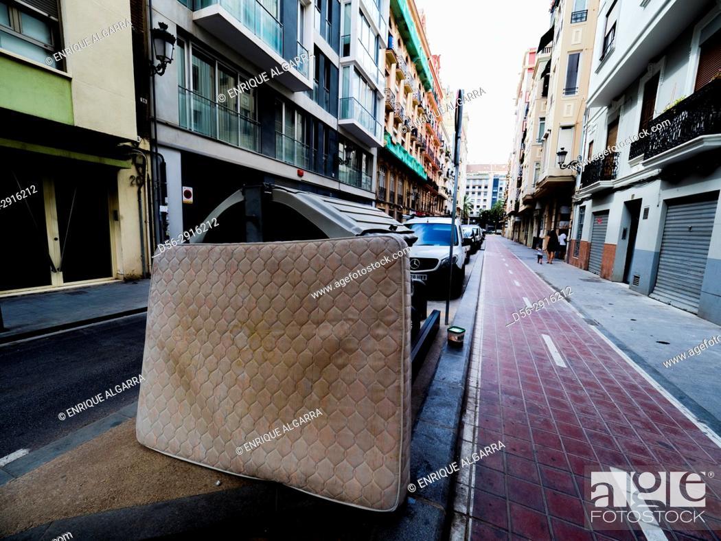 Stock Photo: Mattress in the street, Valencia, Spain.