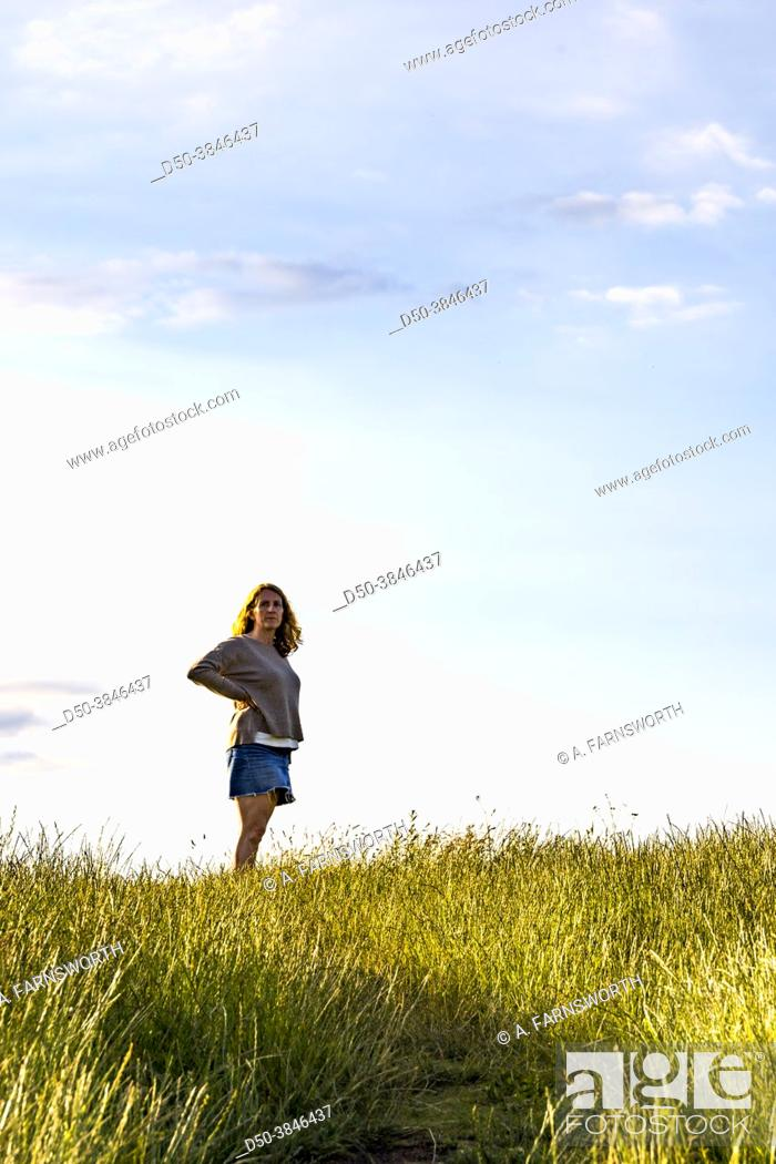 Stock Photo: Mors, Denmark A woman walking across the agricultural landscape of the Mors island in central Denmark.