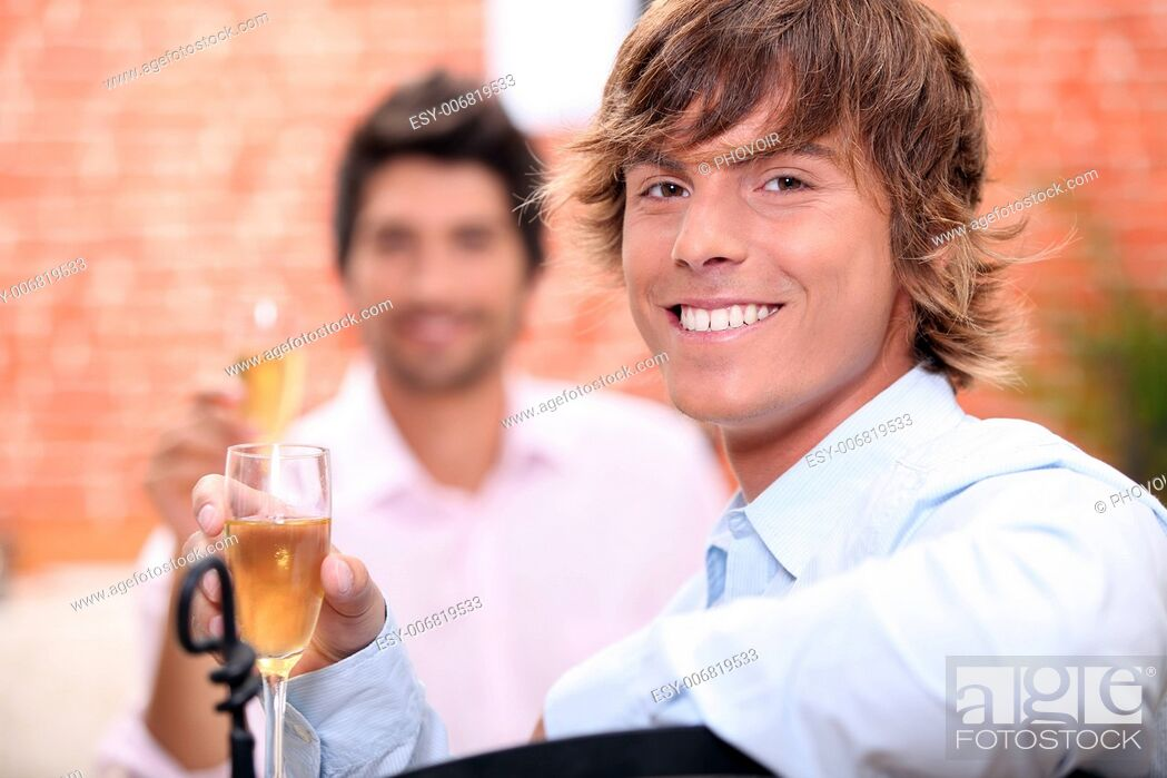 Photo de stock: Men drinking champagne in a restaurant.