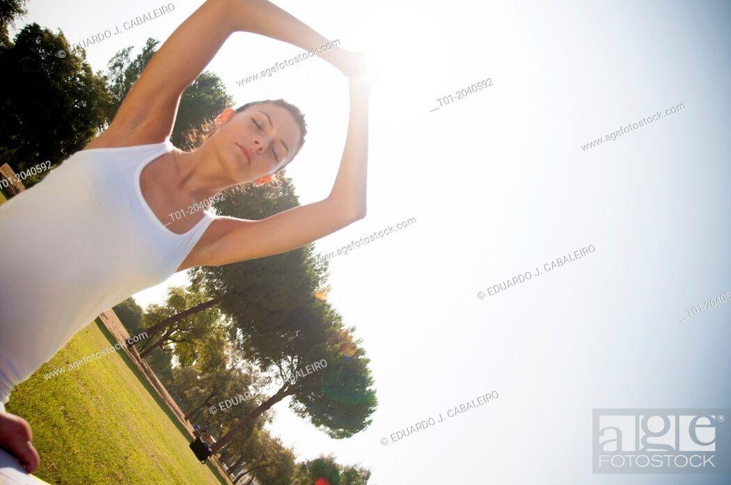 Stock Photo: yoga girl in a park.