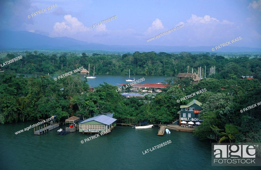 Stock Photo: River town. Houses. backpackers hostel on thin strip of land. Thick woods.