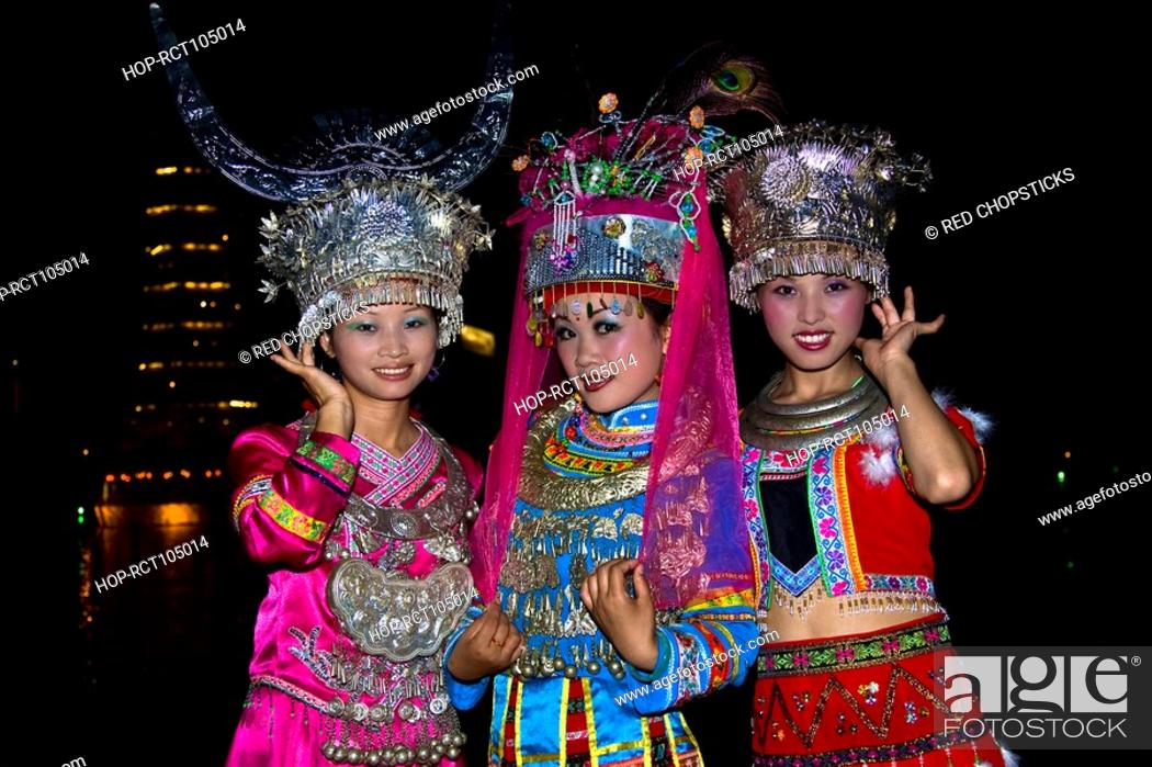 Stock Photo: Portrait of two young women and a teenage girl smiling, Guilin, Guangxi Province, China.
