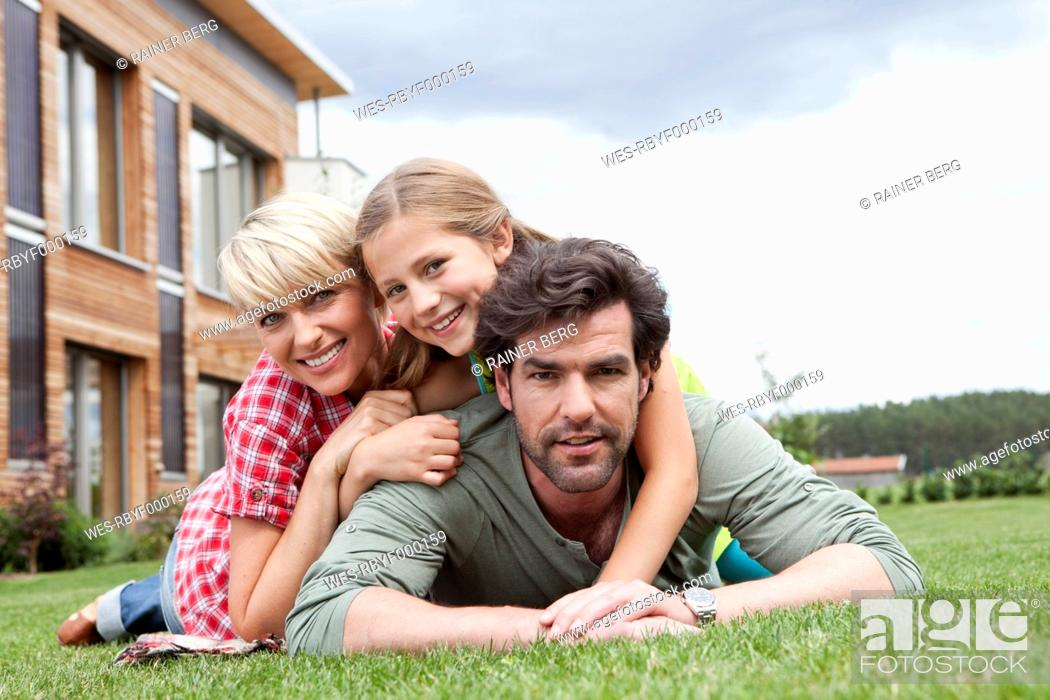 Stock Photo: Germany, Bavaria, Nuremberg, Portrait of family in front of house.