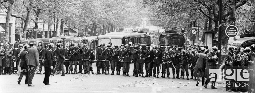 Stock Photo: A police cordon, Boulevard Saint-Michel, Latin Quarter of Paris, May 1968. Widespread protests and riots by students opposed to the policies of the government.