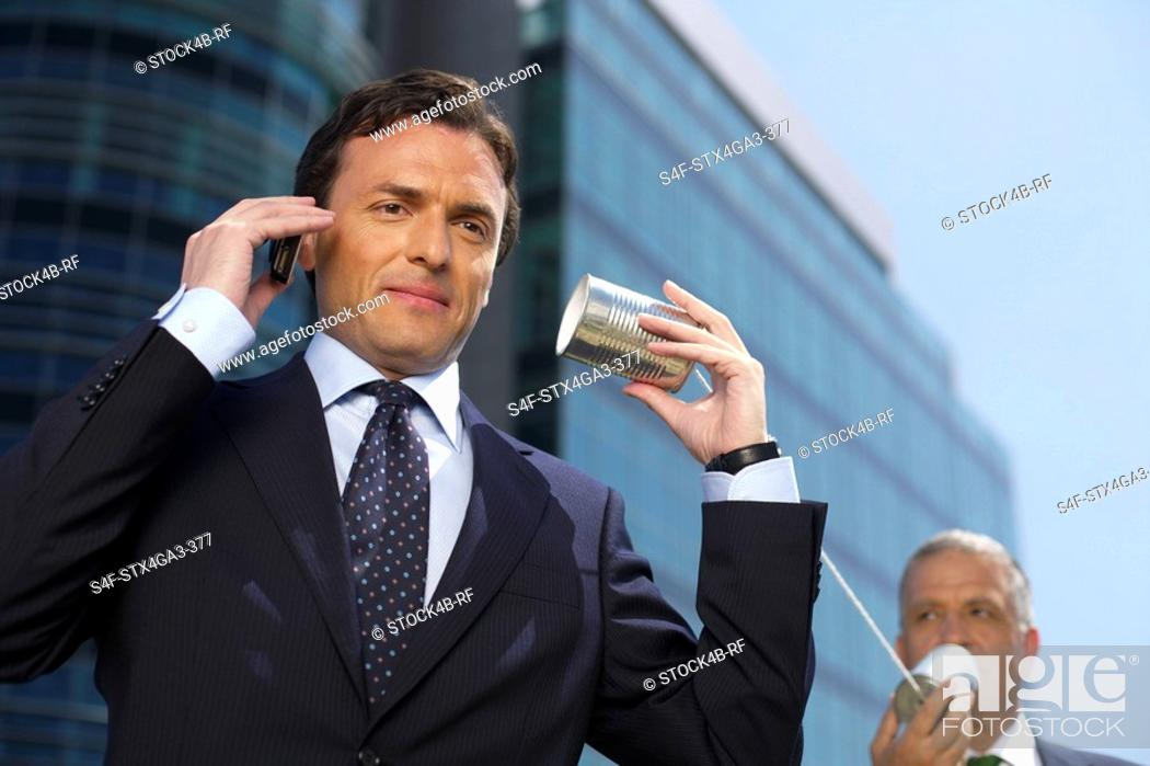 Stock Photo: Two Businessmen with a tin can telephone.