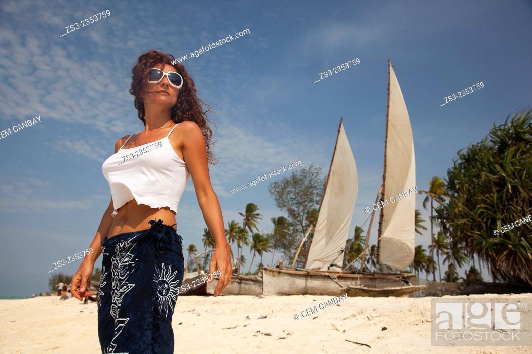 Stock Photo: Woman posing at Nungwi beach, Zanzibar, Tanzania, East Africa.