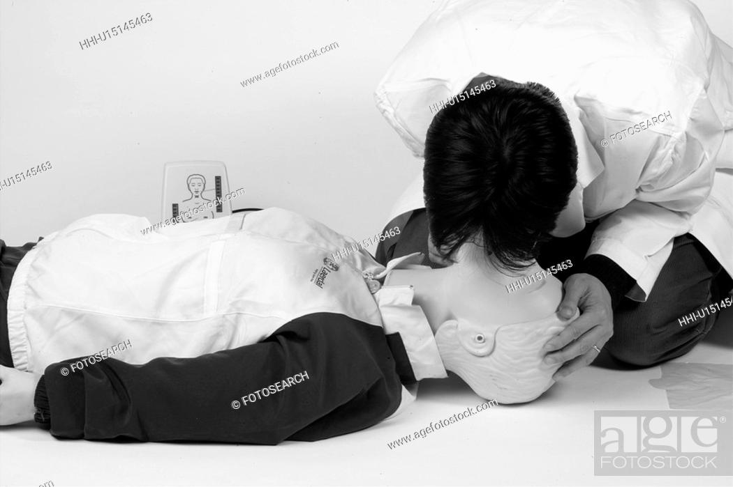Stock Photo: emergency, doctor, first aid, cardiopulmonary resuscitation, artificial respiration, mannequin.
