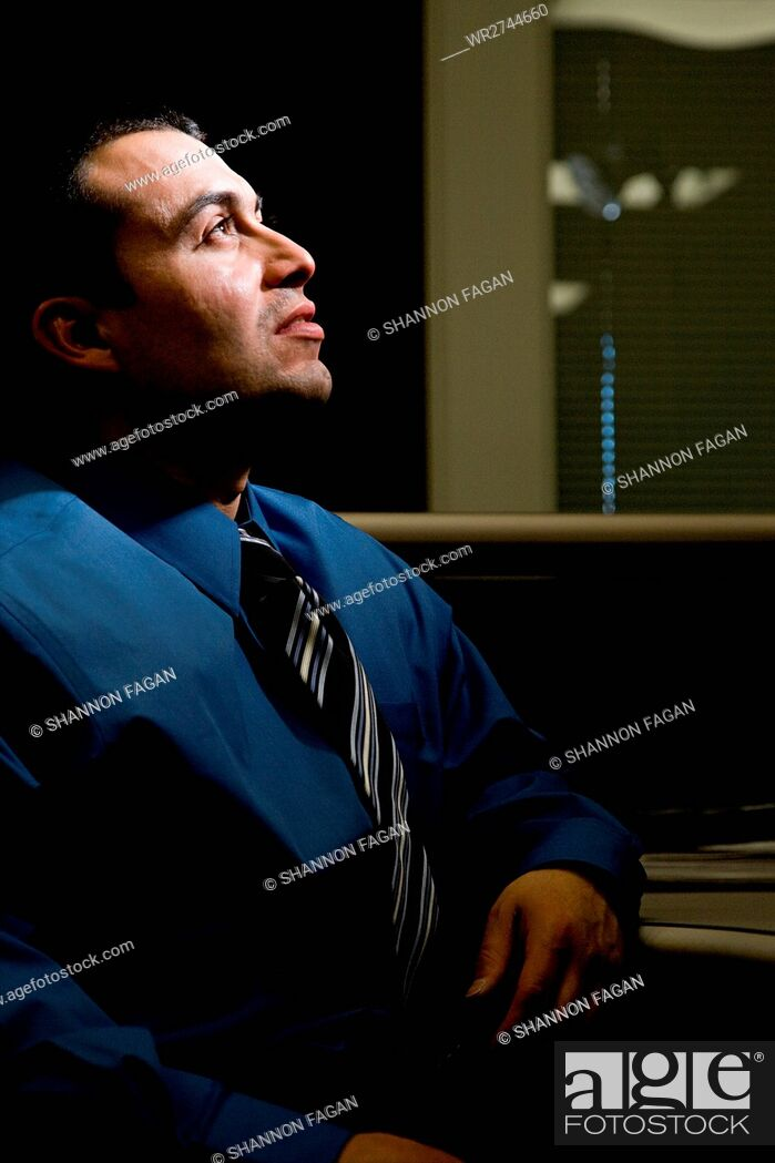 Stock Photo: Man in dark office.