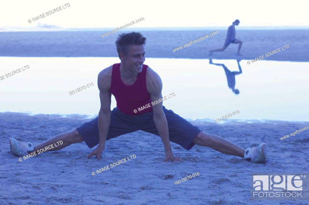Stock Photo: Man exercising at dawn.