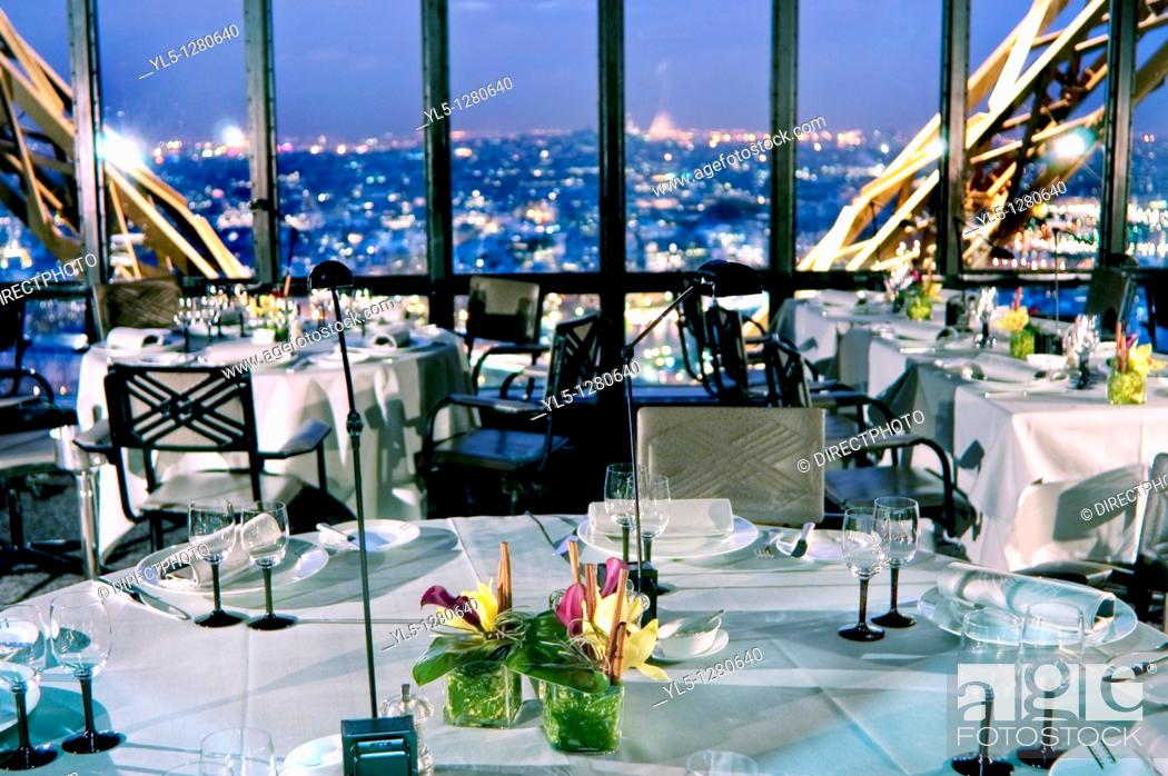 Stock Photo: Paris, France, Haute-Cuisine French Cuisine Restaurant in Eiffel Tower, Jules Verne, Dining Room with Overview at Dusk.