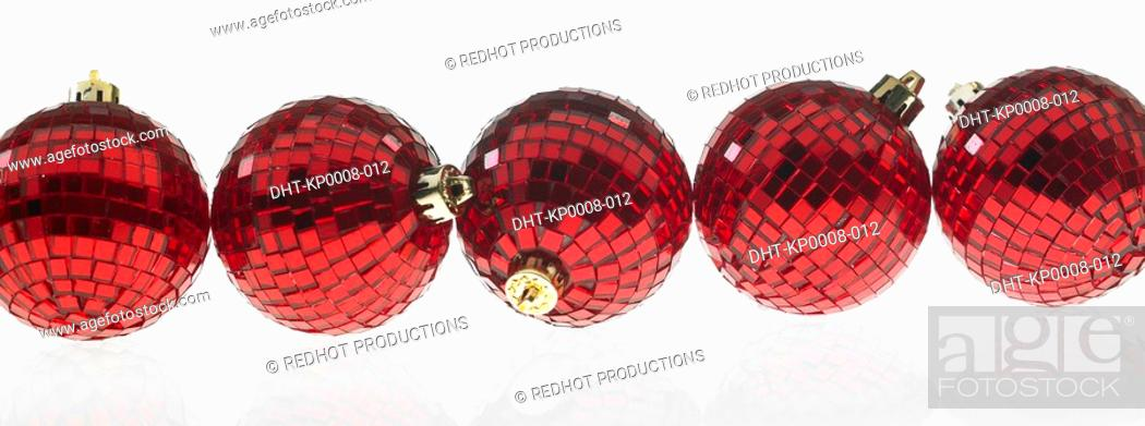 Stock Photo: Five red Christmas Baubles in a row.