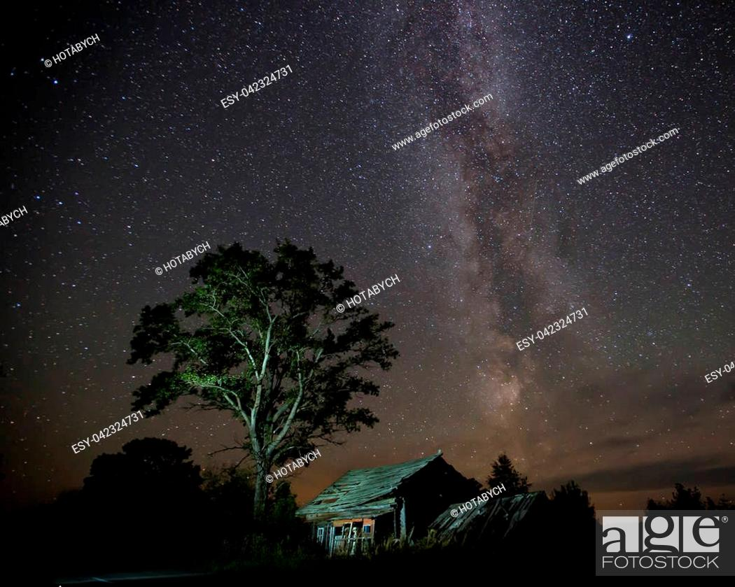 Stock Photo: The Milky Way and the old house.
