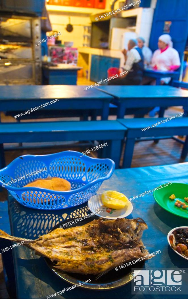 Stock Photo: Fried fish in restaurant at fish souq market in Mellah the old Jewish quarter of Essaouira central Morocco northern Africa.