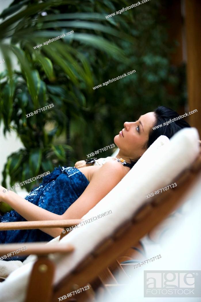 Stock Photo: Woman on deckchair.