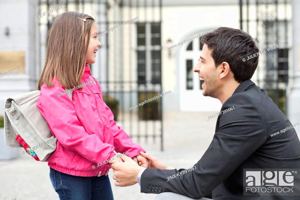 Stock Photo: Man talking to his daughter.