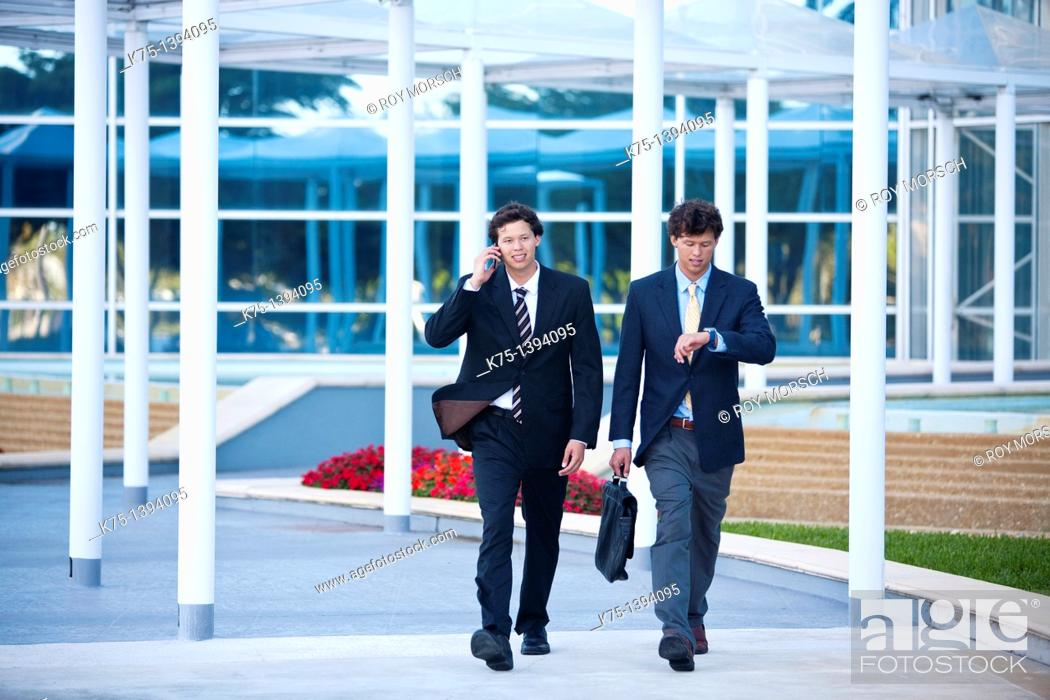 Stock Photo: Twin businessmen in a hurry.