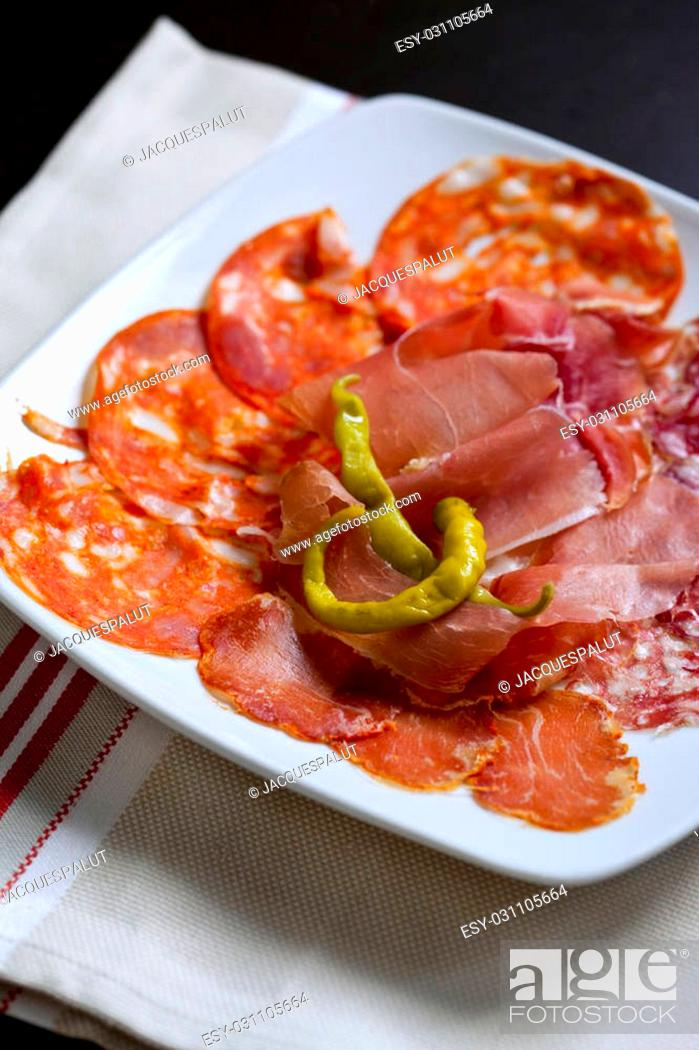 Stock Photo: Close up of ham, sausage and peppers in a plate.