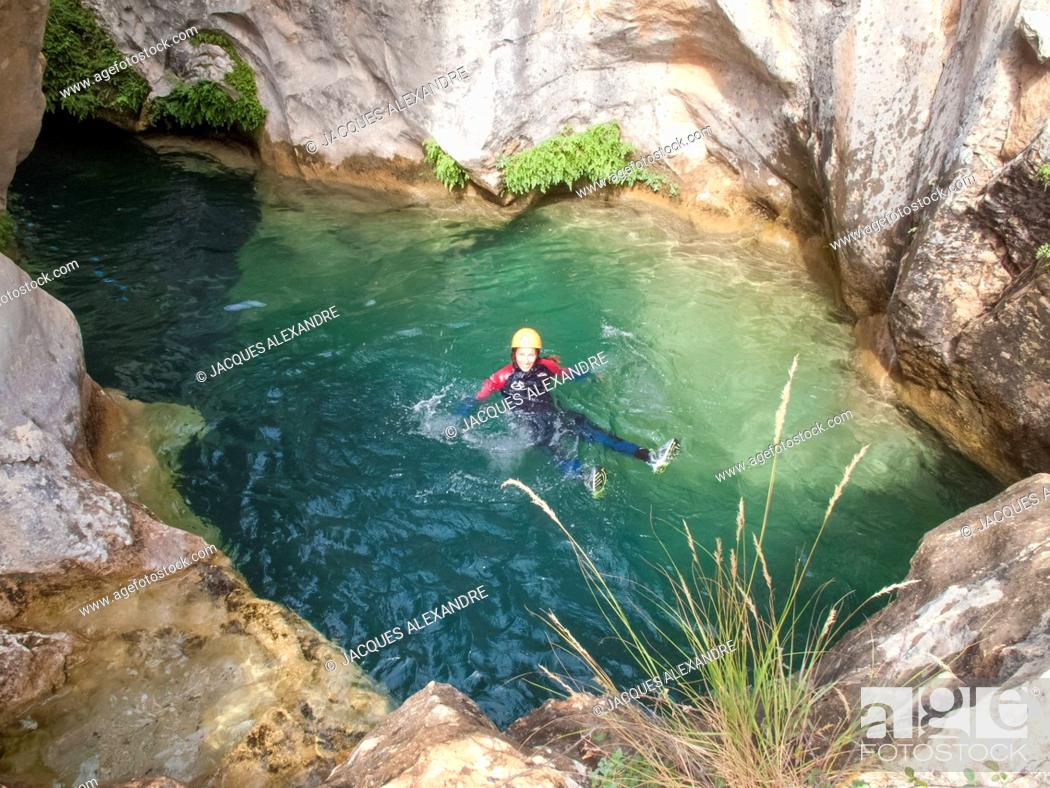 Stock Photo: woman doing canyoning.