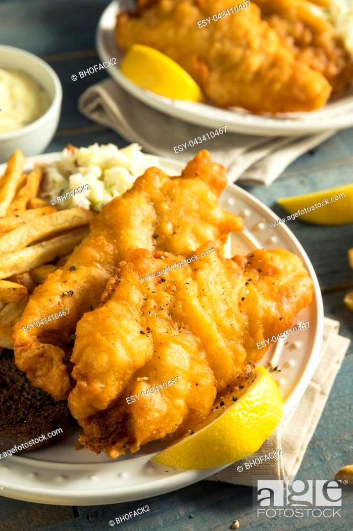 Stock Photo: Homemade Beer Battered Fish Fry with Coleslaw and Chips.