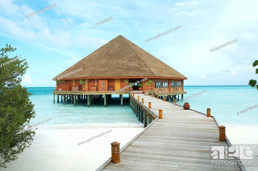 Stock Photo: Boardwalk guiding to resort in Maldives Island, Indian Ocean.