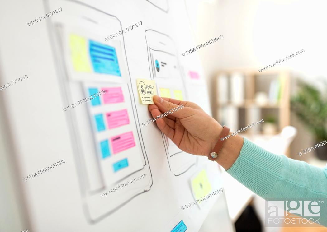 Stock Photo: hand of developer working on ui design at office.