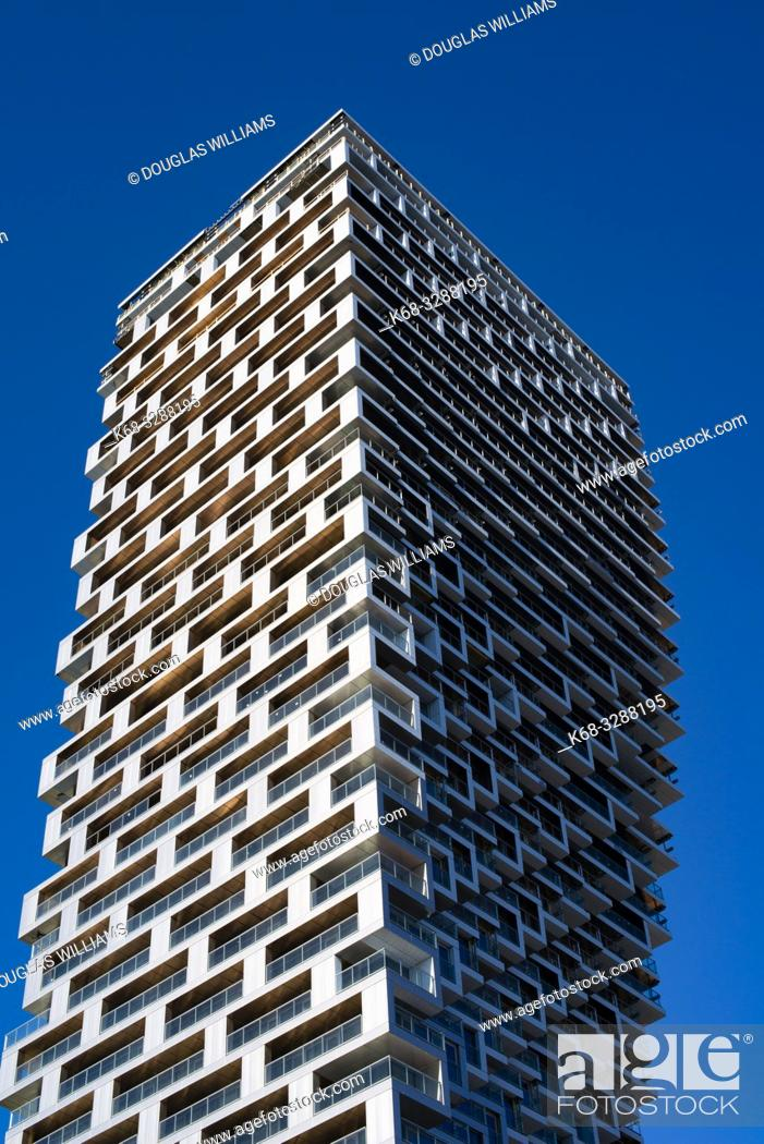 Stock Photo: Vancouver House, a new tower in downtown Vancouver, BC, Canada, designed by BIG, Bjarke Ingels Group architects.