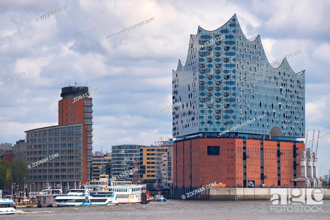 Stock Photo: Elbphilharmonie concert hall in Hamburg with the boats marina on the front.