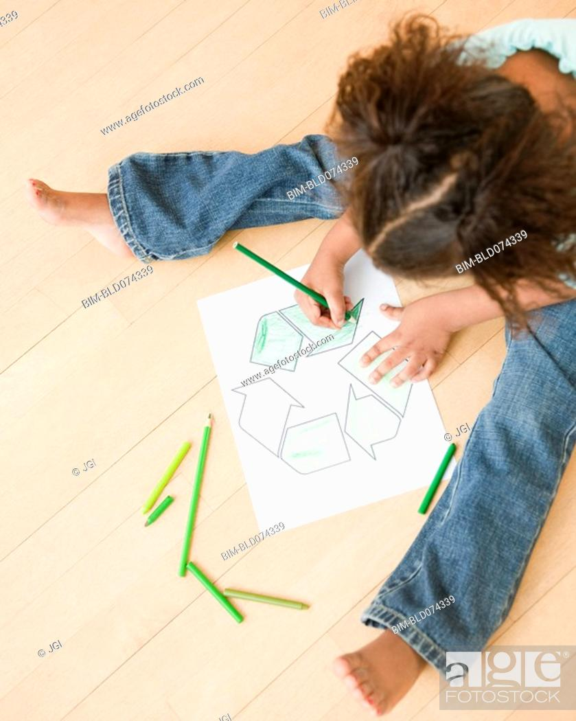 Stock Photo: African girl coloring recycling symbol.