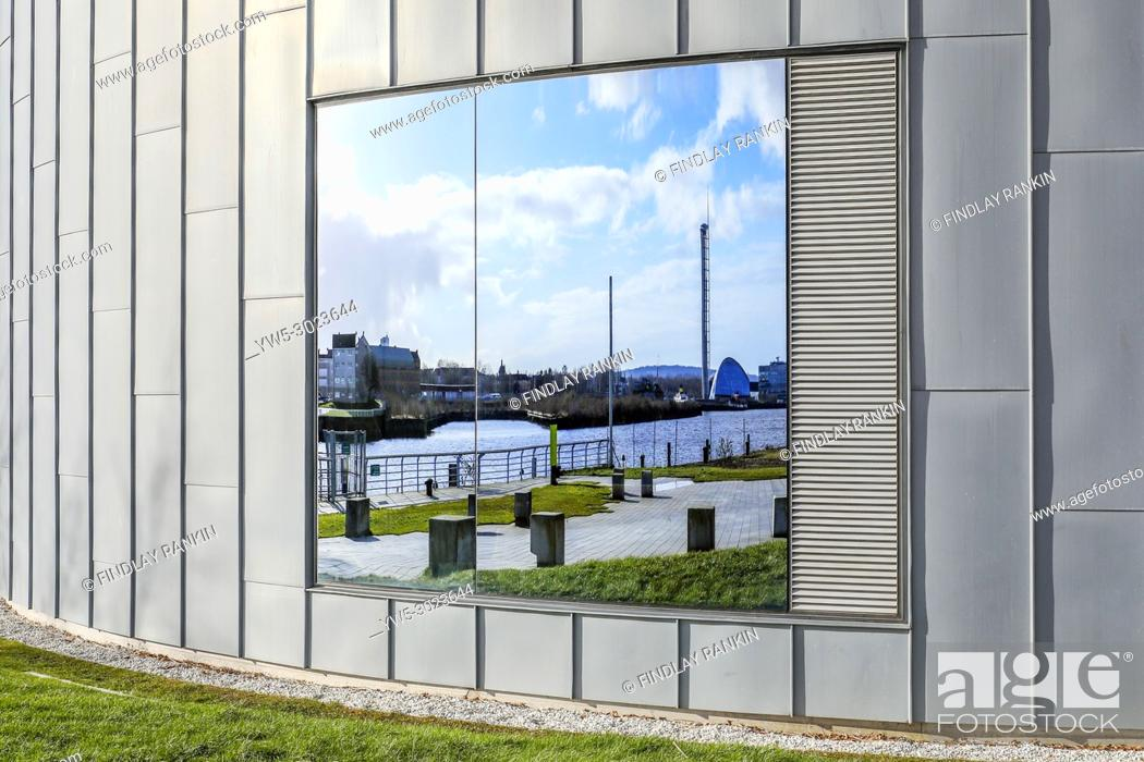 Stock Photo: Reflection of the River Clyde, disused Govan docks and the science centre in the window of the Transport museum, Anderston, Glasgow, Scotland, UK.