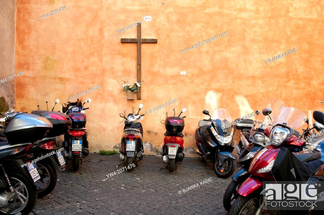 Stock Photo: Cross and motorbikes, Rome, Italy.