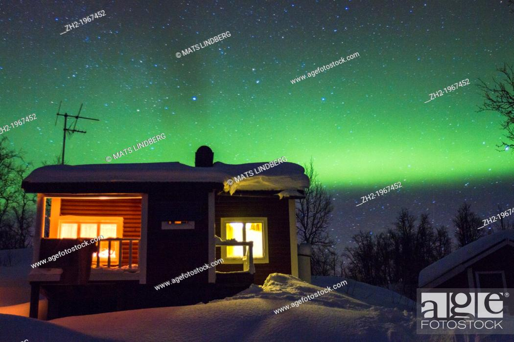 Stock Photo: Cottage with northern light, aurora borealis in background in winter time at Riksgränsen in swedish lapland.