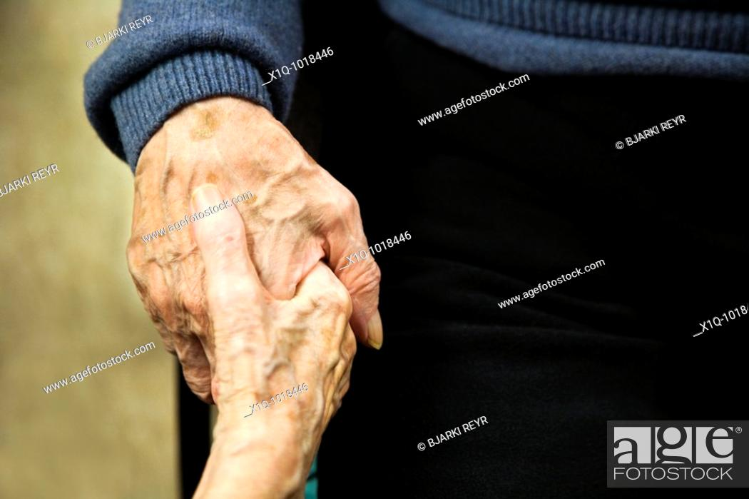 Stock Photo: Old man and woman holding hands.