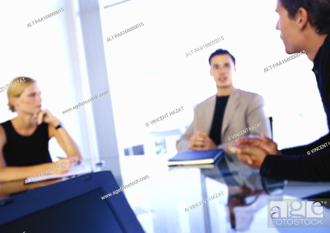 Stock Photo: Business people sitting at desk.