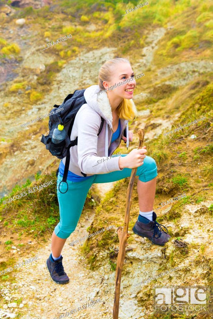Stock Photo: Woman hiking in mountain.