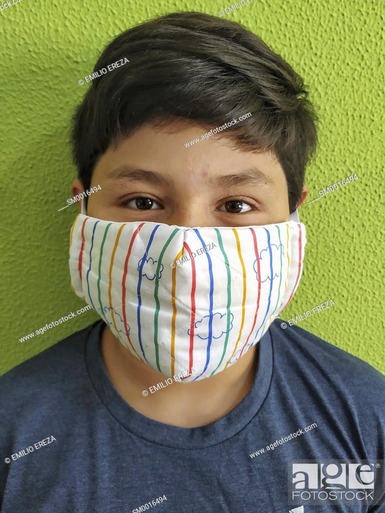 Stock Photo: Little boy wearing a mask.