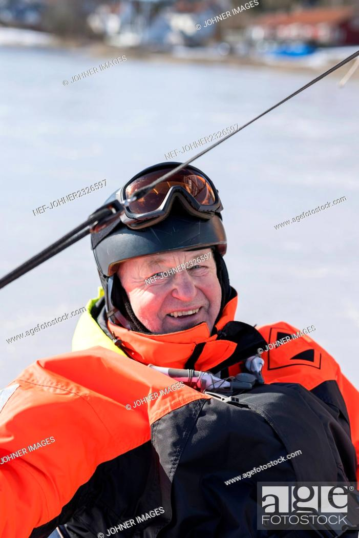 Photo de stock: Man on ice boat.