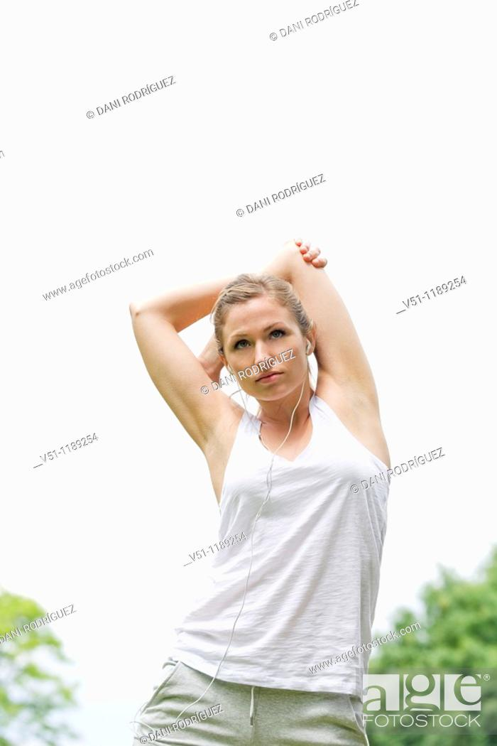 Stock Photo: Blonde woman stretching in the park.