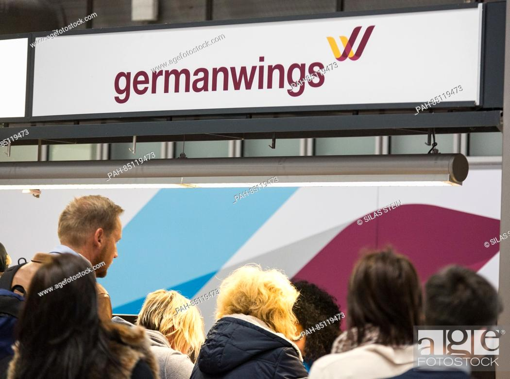 Passengers Queue In Front Of A Germanwings Check In Desk In The