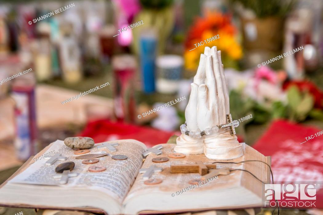 Visitors leave prayer stations along the giant memorial to