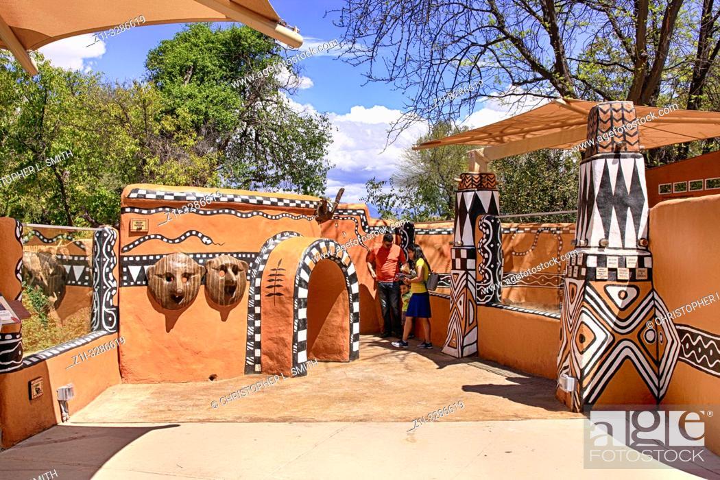Stock Photo: People enjoying Meerkat world at Reid Park Zoo in Tucson AZ.