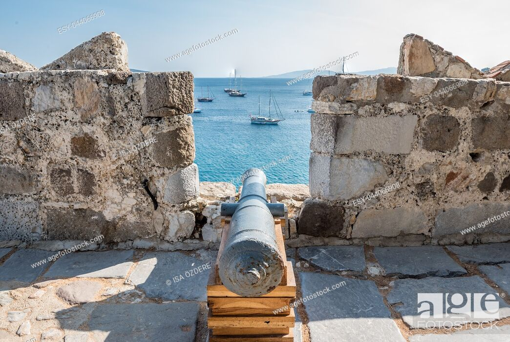 Stock Photo: Aerial view of ancient disused cannon and Bodrum Marine with yachts from top of St. Peter Castle or Bodrum Castle in Turkey.