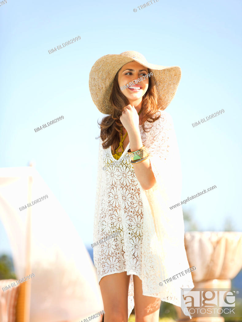 Stock Photo: Smiling Caucasian wearing cover-up and hat.
