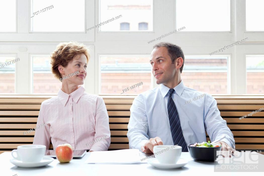Stock Photo: Business colleagues having lunch together.