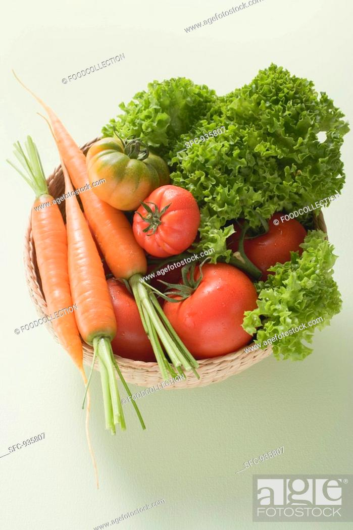Stock Photo: Fresh tomatoes, carrots and lettuce in small basket.