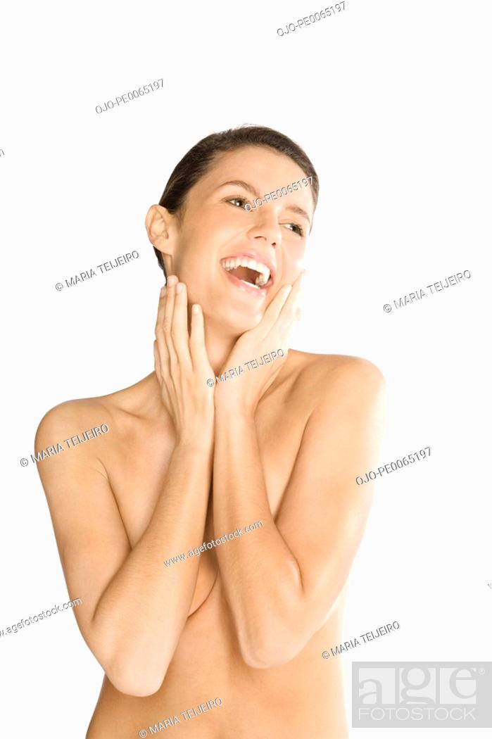 Stock Photo: Nude woman covering her breasts.