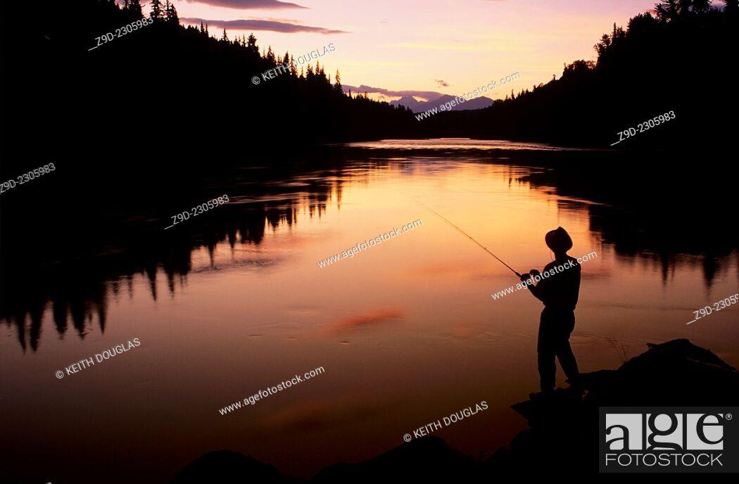 Stock Photo: Angler fishing at sunset, Bulkley river, Smithers, BC, Canada.