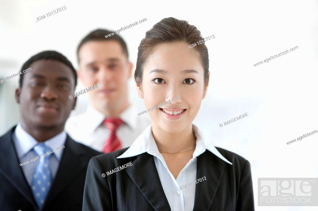 Stock Photo: Business people smiling and looking at the camera together.